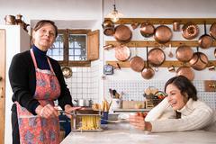 Italian women making pasta - stock photo