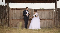 Groom playing the flute for the bride of straw - stock footage