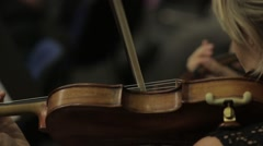 Hand On The Strings Of A Violin - stock footage