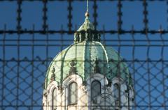 Church dome behind metal fence - stock photo