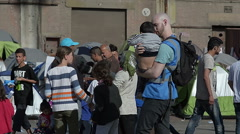 EDITORIAL: The social worker carry the lost Syrian boy home to his parents Stock Footage