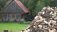 Wood pile near rural house with vintage attribute at forest. 4K Stock Footage
