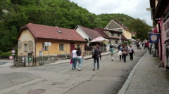 tourists go to the castle in Karlstejn Town below the Karlstejn castle , Bohemia - stock footage