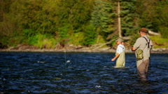 Skilled hobby fisherman casting line freshwater river fishing USA - stock footage
