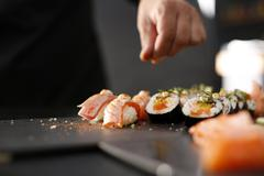 Classic thick rolls futomaki served on a stone plate Stock Photos