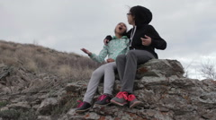 Two girls singing on the mountain Stock Footage