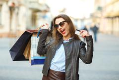 Sale, shopping, tourism and happy people concept - beautiful woman with shopp - stock photo