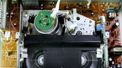 Inserting a VHS Tape into a VCR Player and showing how it works Stock Footage