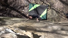 Slow Motion Pan Reveals Cute Young Climber Girl From Mossy Rocks Stock Footage