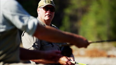 Fisherman using rod and reel casting line in freshwater river USA Stock Footage