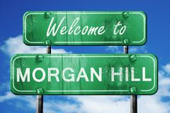 morgan hill vintage green road sign with blue sky background - stock illustration