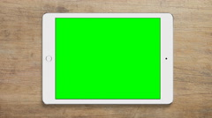 4K - Ipad tablet green screen top view - stock footage