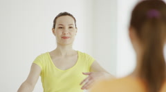 Young women are practicing yoga indoors Stock Footage