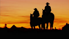 Silhouette of Cowboy Riders forest wilderness area Canada - stock footage