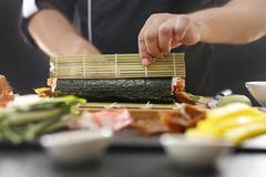 Sushi master preparing sushi in Japanese restaurant Stock Photos