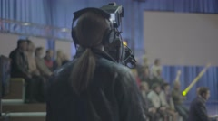 Cameraman works in the Studio (seen from behind) Stock Footage