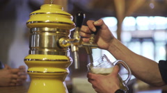 Stock Video Footage of Hand at beer tap pouring a draught lager beer at restaurant