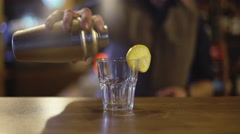 Bartender is making cocktail at bar counter Stock Footage