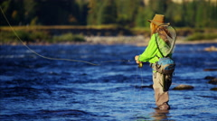 Skilled female casting line freshwater fishing Canada - stock footage