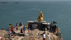 People visit Buddha statue at the cliff in Busan, Korea. Stock Footage