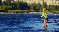 Skilled hobby female casting line freshwater fishing Canada - stock footage