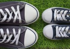 Classic sneakers on the green grass Stock Photos