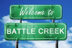 Battle creek vintage green road sign with blue sky background Stock Illustration