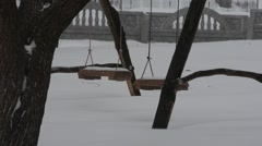 Swing seat with snow cap Stock Footage