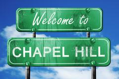chapel hill vintage green road sign with blue sky background - stock illustration