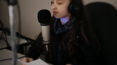 Portrait of female dj working in front of a microphone on the radio Stock Footage