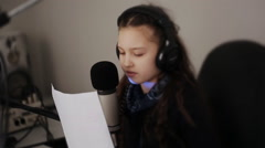 Portrait of girl dj working on the radio in front of a microphone Stock Footage