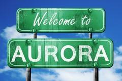 aurora vintage green road sign with blue sky background - stock illustration
