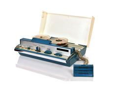 Reel tape recorder with microphone - stock photo