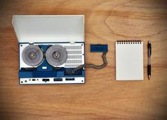 Reel tape recorder and blank notepad Stock Photos