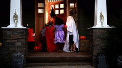 Trick or treating on Halloween Stock Footage