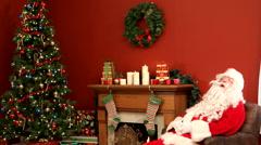 Santa Claus sleeping in living room - stock footage