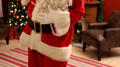 Santa Claus with bag of gifts - stock footage