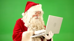 Santa Claus with laptop computer Stock Footage