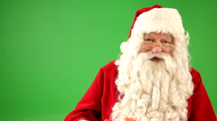 Santa Claus holding up Christmas gift - stock footage
