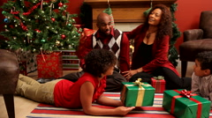 Family passing out Christmas presents Stock Footage