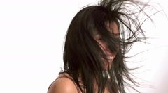 Young woman with hair blowing - stock footage