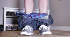 Man Lowers and Raises Pants Exposing Himself Stock Footage