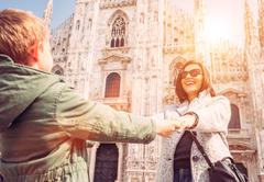 Mother wit son take for hands on the squere near Duomo di Milano - stock photo