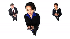 Three businesspeople texting with cell phones Stock Footage