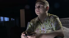 a Young Man With a Game Console in a Dark Room Cafe With Passion Keen Computer - stock footage