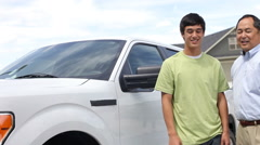 Father hands son keys to truck Stock Footage