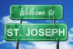 st. joseph vintage green road sign with blue sky background - stock illustration