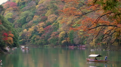 River boats & autumn colour, Arashiyama - stock footage