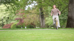 Couple riding tandem bicycle - stock footage