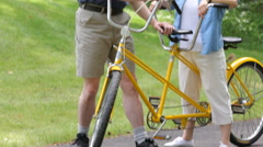 Mature Asian couple with tandem bicycle Stock Footage